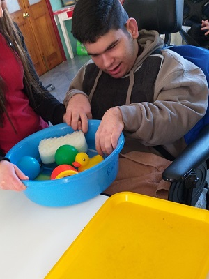Manuel - Exploring a range of objects and water toys with visual and tactile interest